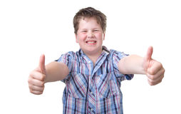 Boy with Power thumbs up, isolated on white Royalty Free Stock Image