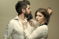 Boy Powered. Issues face boys. Guy with modern hairstyle visiting hairdresser. Barbershop or hairdresser concept. Woman. Hairdresser cuts beard with scissors royalty free stock images