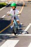 Boy practice biking on the road Stock Photos