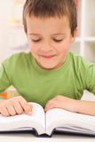 Boy practice reading at home Royalty Free Stock Image