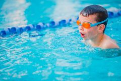 Boy Practice Swimming. And swimming Freestyle in the pool Stock Photo