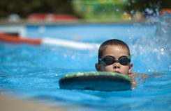 Boy practice swimming. Contestant receives instructions from their coach while in the pool Stock Photo