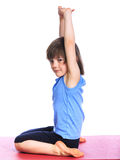 Boy practice yoga. Cute little boy practice yoga. Isolated on the white background Royalty Free Stock Photography