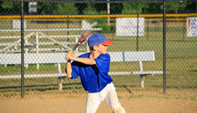 Boy Practicing Baseball