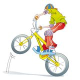 Boy practicing bike pirouettes. Boy doing tricks and pirouettes on his bike, playing style bmx Royalty Free Stock Photo