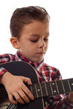 Boy practicing eith guitar Stock Images