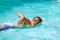 Boy practicing freestyle in pool. Royalty Free Stock Photo