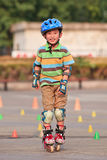 Boy practicing inline skating, Beijing, China Stock Images