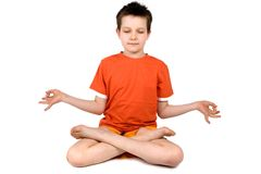 Boy practicing meditation Royalty Free Stock Image
