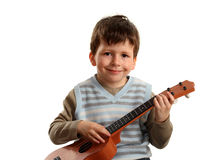 Boy practicing playing guitar Stock Image