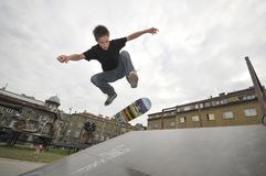 Boy practicing skateboarding. Boy practicing skate in a skate park Stock Photography