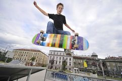 Boy practicing skateboarding Royalty Free Stock Images