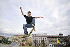 Boy practicing skateboarding Royalty Free Stock Image