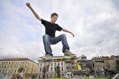 Boy practicing skateboarding stock photo
