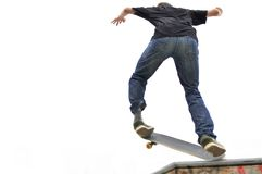 Boy practicing skateboarding Royalty Free Stock Photos