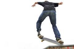 Boy practicing skateboarding Royalty Free Stock Photos