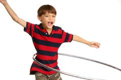 Boy practising the hula-hoop. Young boy practising the hula-hoop Royalty Free Stock Images
