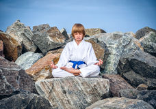 Boy practising yoga on beach Royalty Free Stock Image