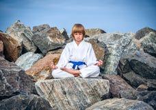 Free Boy Practising Yoga On Beach Royalty Free Stock Image - 32713246