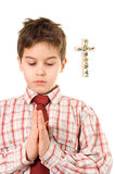 Boy praying. Little boy holding his hands in prayers royalty free stock images