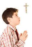 Boy praying. Little boy holding his hands in prayers royalty free stock photo
