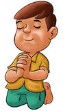 Boy praying Stock Image