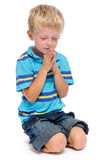 Boy praying Stock Images