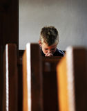 Boy is praying. The little boy is praying in the church Royalty Free Stock Image