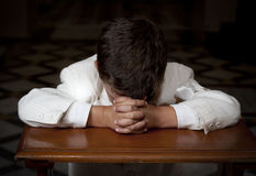 Boy praying royalty free stock image