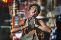 Boy praying in front of the Jokhang Temple in Tibet