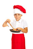 Boy prepare macaroni Stock Image