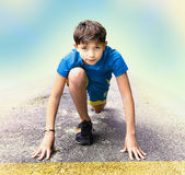 Boy  prepare to have running event contest Royalty Free Stock Photos
