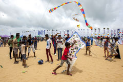 A boy prepares to launch a kite on Negombo beach in Sri Lanka during the annual kite festival. Stock Photos
