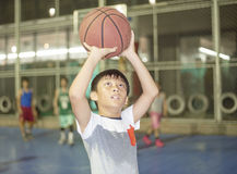 Boy preparing for basketball shooting at sports field Royalty Free Stock Photo