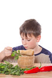 Boy preparing breakfast. On a white background Stock Images