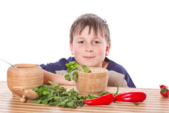 Boy preparing breakfast. On a white background Royalty Free Stock Images