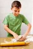Boy preparing cookies or bread Stock Image