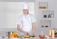 Boy preparing meals Royalty Free Stock Photography