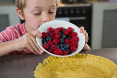 Boy preparing tart with berries Royalty Free Stock Photography