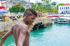 Boy preparing to jump into the water in Salvador, Brazil Royalty Free Stock Photos