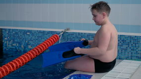The boy is preparing to swim in the pool. Professional stock video