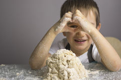 Boy is prepearing pizza dough Stock Images