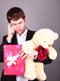 Boy with present box and teddy bear Stock Images