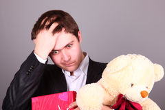Boy with present box and teddy bear Royalty Free Stock Image