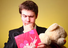 Boy with present box and teddy bear Royalty Free Stock Photos