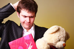 Boy with present box and teddy bear Royalty Free Stock Images