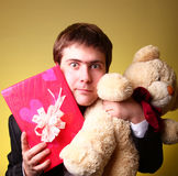 Boy with present box and teddy bear Royalty Free Stock Photography
