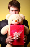 Boy with present box and teddy bear Stock Photo