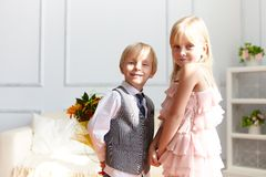 Boy is presented flowers to girl Royalty Free Stock Image