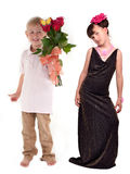 Boy presenting bunch of flowers to the girl Stock Photos